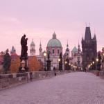 Charles Bridge and spires of old town Prague at dawn