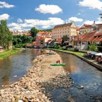 taking the Vltava River around the medieval town of Český Krumlov – Czech Republic
